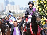Damien Oliver riding Fiorente after wining the Emirates Melbourne Cup during Melbourne Cup Day at Flemington Racecourse on November 5, 2013