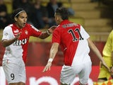 Monaco's Colombian forward Radamel Falcao celebrates a goal with Monaco's Argentinian midfielder Lucas Ocampos during the French L1 football match Monaco vs Evian TG on November 8, 2013
