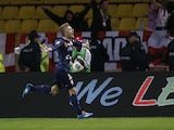 Evian's Danish defender Daniel Wass celebrates after scoring a goal during the French L1 football match Monaco vs Evian TG on November 8, 2013