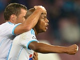 Marseille's Ghanaian forward Andre Ayew celebrates his goal with French midfielder Benoit Cheyrou during an UEFA Champions League group F football match between SSC Napoli and Olympique de Marseille at the San Paolo Stadium in Naples on November 6, 2013