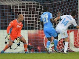 Marseille's French midfielder Florian Thauvin scores a goal past Napoli's Spanish goalkeeper Jose Manuel Reina and Colombian defender Pablo Armero during the UEFA Champions League group F football match SSC Napoli vs Olympique de Marseille at the San Paol