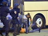 A Napoli's supporter is arrested by police as riot policemen clash with Napoli's supporters outside the Velodrome stadium on October 22, 2013