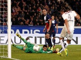 Paris Saint-Germain's Italian goalkeeper Salvatore Sirigu concedes a goal to Nice's Serbian defender Nemanja Pejcinovic during the French L1 football match on November 9, 2013