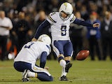 Kicker Nick Novak #9 of the San Diego Chargers kicks the point after touchdown as holder Mike Scifres #5 releases the ball against the Oakland Raiders in the fourth quarter on October 06, 2013