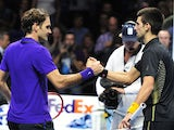 Serbia's Novak Djokovic shakes hands with Switzerland's Roger Federer after Djokovic won the singles final on the eighth day of the ATP World Tour Finals tennis tournament in London on November 12, 2012