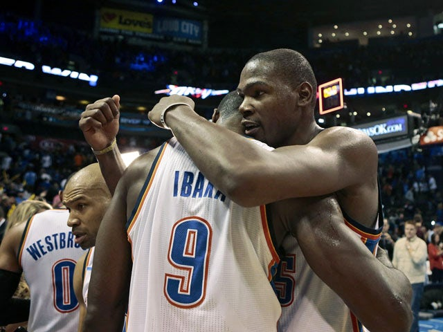 Kevin Durant #35 hugs Serge Ibaka #9 of the Oklahoma City Thunder after the game against the Phoenix Suns November 3, 2013