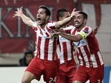 Olympiacos' Greek defender Kostas Manolas celebrates scoring a goal during the UEFA Champions League Group C football match Olympiacos vs Benfica on November 5, 2013