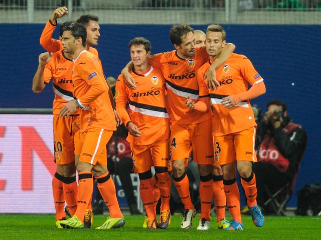 Valencia's Agentinian forward Pablo Piatti is congratulated after scoring a goal during the UEFA Europa League Group A football match between FC Saint Gallen on November 7, 2013