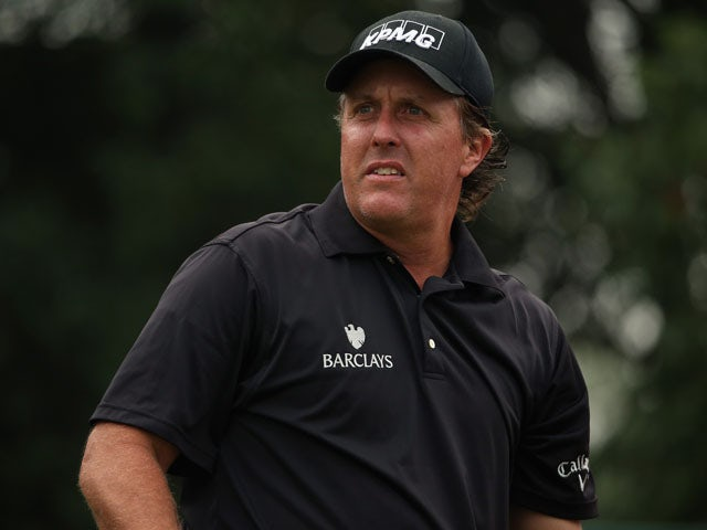 Phil Mickelson of the USA waits to play on the first hole during the final round of the WGC - HSBC Champions at the Sheshan International Golf Club on November 3, 2013