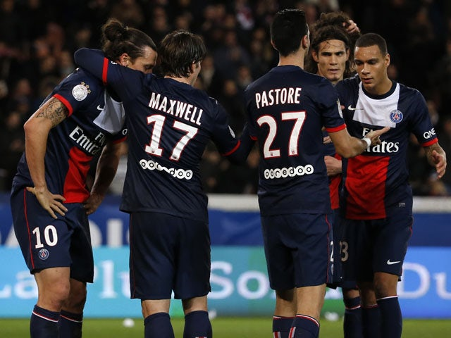 Paris Saint-Germain's players celebrate after Swedish forward Zlatan Ibrahimovic scored a goal during the French L1 football match between PSG and Nice at the Parc des Princes in Paris on November 9, 2013