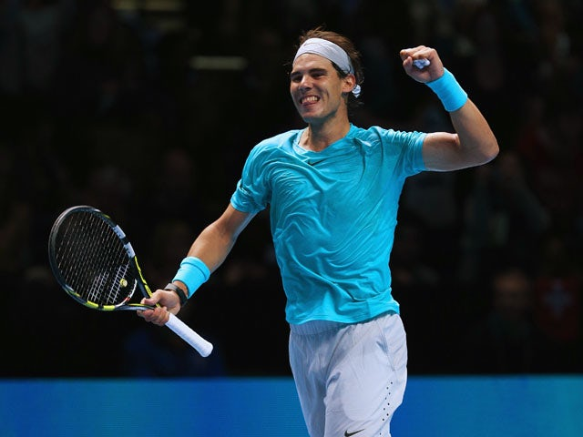 Rafael Nadal of Spain celebrates winning his men's singles match against Stanislas Wawrinka of Switzerland during day three of the Barclays ATP World Tour Finals at O2 Arena on November 6, 2013