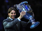 Spain's Rafael Nadal poses with the 2013 ATP World Number One trophy on the sixth day of the ATP World Tour Finals tennis tournament in London on November 9, 2013