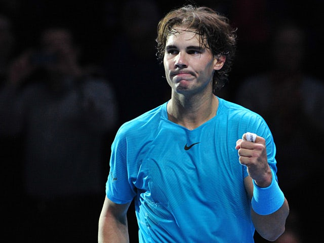 Rafael Nadal celebrates victory over Roger Federer during their semi final match at the ATP World Tour Finals on November 10, 2013