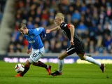 David Templeton of Rangers and Ross Millen of Dunfermline challenge during the Scottish League One match between Rangers and Dunfermline at Ibrox Stadium on November 6, 2013
