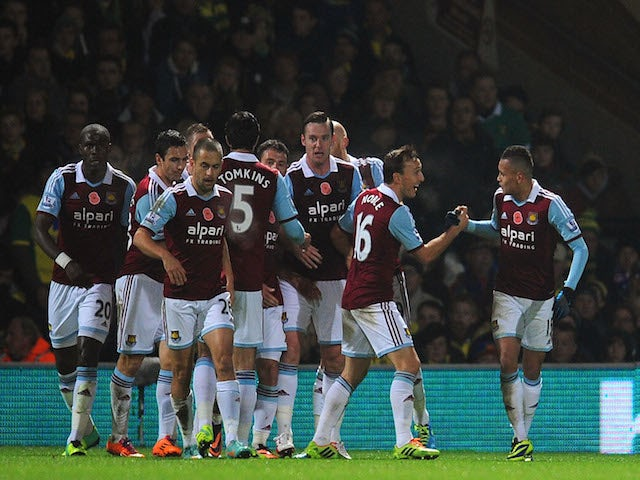 Goalscorer for West Ham United Ravel Morrison celebrates with Mark Noble during the Barclays Premier League match between Norwich City on November 9, 2013