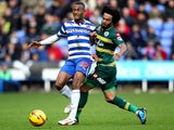 Benoit Assou-Ekotto of QPR battles with Jordan Obita of Reading during the Sky Bet Championship match between Reading and Queens Park Rangers at Madejski Stadium on November 09, 2013