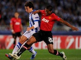 Ruben Pardo of Real Sociedad battles with Luis Antonio Valencia of Manchester United during the UEFA Champions League Group A match between Real Sociedad de Futbol and Manchester United at Estadio Anoeta on November 5, 2013