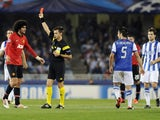 Manchester United's Belgian midfielder Marouane Fellaini receives a red card during the UEFA Champions League Group football match Real Sociedad vs Manchester United at the Anoeta stadium in San Sebastian on November 5, 2013
