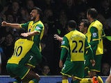 Robert Snodgrass of Norwich City celebrates his goal with Leroy Fer after putting his team 2-1 up against West Ham United on November 9, 2013