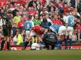 Roy Keane of Manchester United shouts at Alf Inge Haaland of Manchester City following his red card during the FA Carling Premiership match on April 21, 2001