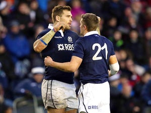 Sean Lamont of Scotland and Henry Pyrgos of Scotland embrace at the end of the match during the International rugby union test match between Scotland and Japan at Murrayfield Stadium in Edinburgh on November 9, 2013
