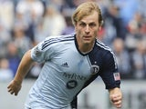 Seth Sinovic of Sporting Kansas City works the ball against the Chicago Fire at Sporting Park on March 16, 2013