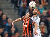 Shakhtar's Argentinian forward Facundo Ferreyra jumps for the ball with Leverkusen's Turkish defender Omer Toprak during the UEFA Champions League Group A football match Shakhtar Donetsk vs Bayer Leverkusen in Donetsk on November 5, 2013