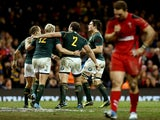South Africa celebrate a try as George North of Wales looks dejected during an International between Wales and South Africa at Millennium Stadium on November 9, 2013
