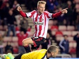 Sunderland's Swedish midfielder Sebastian Larsson celebrates scoring his team's second goal during the English League Cup football match between Sunderland AFC and Southampton FC at the Stadium of Light in Sunderland, northern England, on November 6, 2013