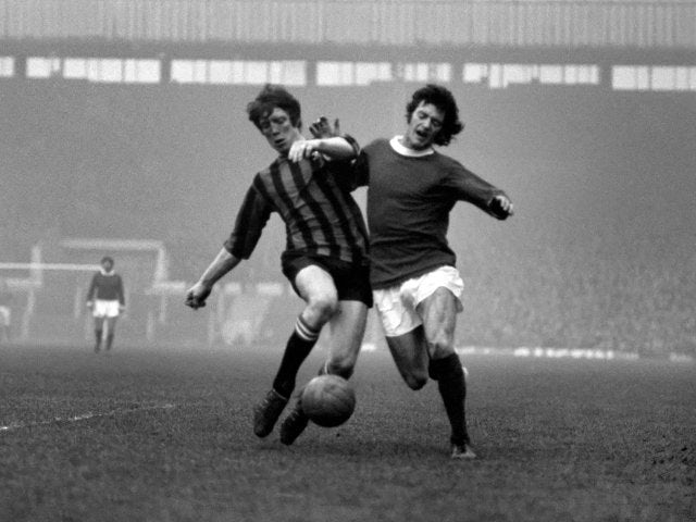 Willie Morgan in action for Manchester United.