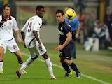 Yuto Nagatomo of FC Inter Milan and Ibrahima Mbaye of AS Livorno Calcio compete for the ball during the Serie A match on November 9, 2013