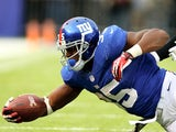Andre Brown of the New York Giants tries to get an extra yard as he is tackled by Kevin Burnett of the Oakland Raiders at MetLife Stadium on November 10, 2013