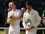 Andy Murray and Novak Djokovic stand with their trophies after the Scot won Wimbledon on July 07, 2013.