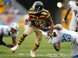 Antonio Brown of the Pittsburgh Steelers runs for a first quarter touchdown between Glover Quin of the Detroit Lions and Chris Houston at Heinz Field on November 17, 2013