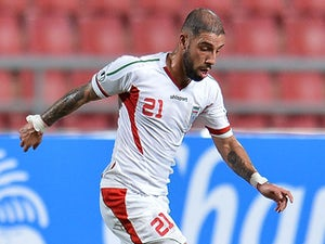 Ashkan Dejagah of Iran during their 2015 Asian Cup group B qualifying football match on November 15, 2013