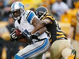 Calvin Johnson of the Detroit Lions breaks a tackle by Ike Taylor of the Pittsburgh Steelers and then runs for a second quarter touchdown at Heinz Field on NovembCalvin Johnson #81 of the Detroit Lions breaks a tackle by Ike Taylor #24 of the Pittsburgh S