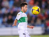 Elche's Carles Gil in action against Getafe during their La Liga match on November 9, 2013