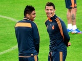 Real Madrid's forward Cristiano Ronaldo of Portugal speaks with Madrid's midfielder Casemiro of Brazil during a training session on the eve of the UEFA Champions League football match Juventus vs Real Madrid at 'Juventus Stadium' in Turin on November 4, 2