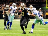 Ernie Sims #59 of the Dallas Cowboys tries to tackle Robert Meachem #17 of the New Orleans Saints during a game at the Mercedes-Benz Superdome on November 10, 2013