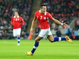Alexis Sanchez of Chile celebrates after scoring the opening goal during the international friendly match between England and Chile at Wembley Stadium on November 15, 2013