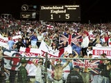 England fans celebrate their 5-1 win over Germany in Munich on September 08, 2001.