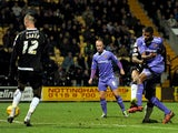 Ethan Ebanks-Landell of Wolverhampton Wanderers scores the opening goal during the Sky Bet League One match against Notts County on November 16, 2013