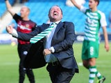 Yeovil Town manager Gary Johnson wildly celebrates the opening day victory over Millwall in the Championship on August 3, 2013