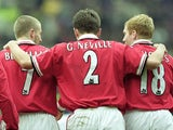 Gary Neville, Paul Scholes and David Beckham celebrate a Manchester United goal against West Ham United on April 01, 2000.