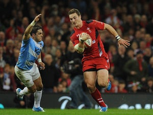 Wales player George North bursts past Horacio Agulla to score the second Wales try during the International Match between Wales and Argentina at the Millennium Stadium on November 16, 2013