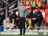 Fleetwood Town manager Graham Alexander gives instructions to his team during the Sky Bet League Two match between against Chesterfield on October 12, 2013