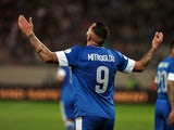 Greece's Kostas Mitroglou celebrates after scoring during the 2014 FIFA World Cup qualifying play-off first leg football match between Greece and Romania at the Karaiskaki stadium in Athens on November 15, 2013