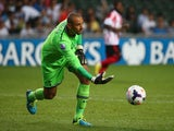 Tottenham Hotspur goalkeeper Heurelho Gomes releases the ball during the Barclays Asia Trophy Semi Final match between Tottenham Hotspur and Sunderland at Hong Kong Stadium on July 24, 2013