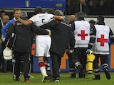 Sami Khedira of Germany is helped off the pitch with an injury during the international friendly match between Italy and Germany at Giuseppe Meazza Stadium on November 15, 2013