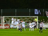 Jake Parrott of Shortwood United hits a free kick during the FA Cup First Round match between Shortwood United and Port Vale at Meadowbank Stadium on November 11, 2013